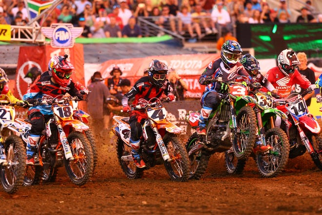 Tomac got a good jump out of the gate, but got shuffled back a little bit by the holeshot line.