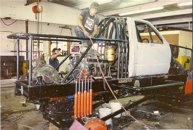 Check out these dudes working on Awesome Kong in the 1980s. There is no business plan to this build.