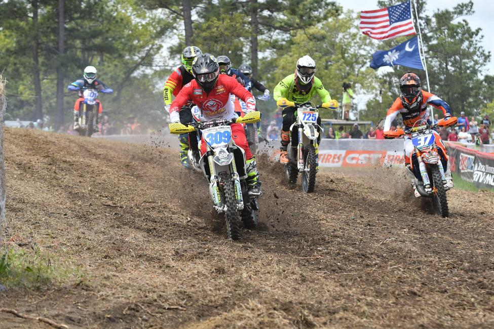 Alex Teagarden (#309) grabbed the FMF XC3 125 Pro-Am holeshot, but Jesse Ansley (#37) was hot on his heels.