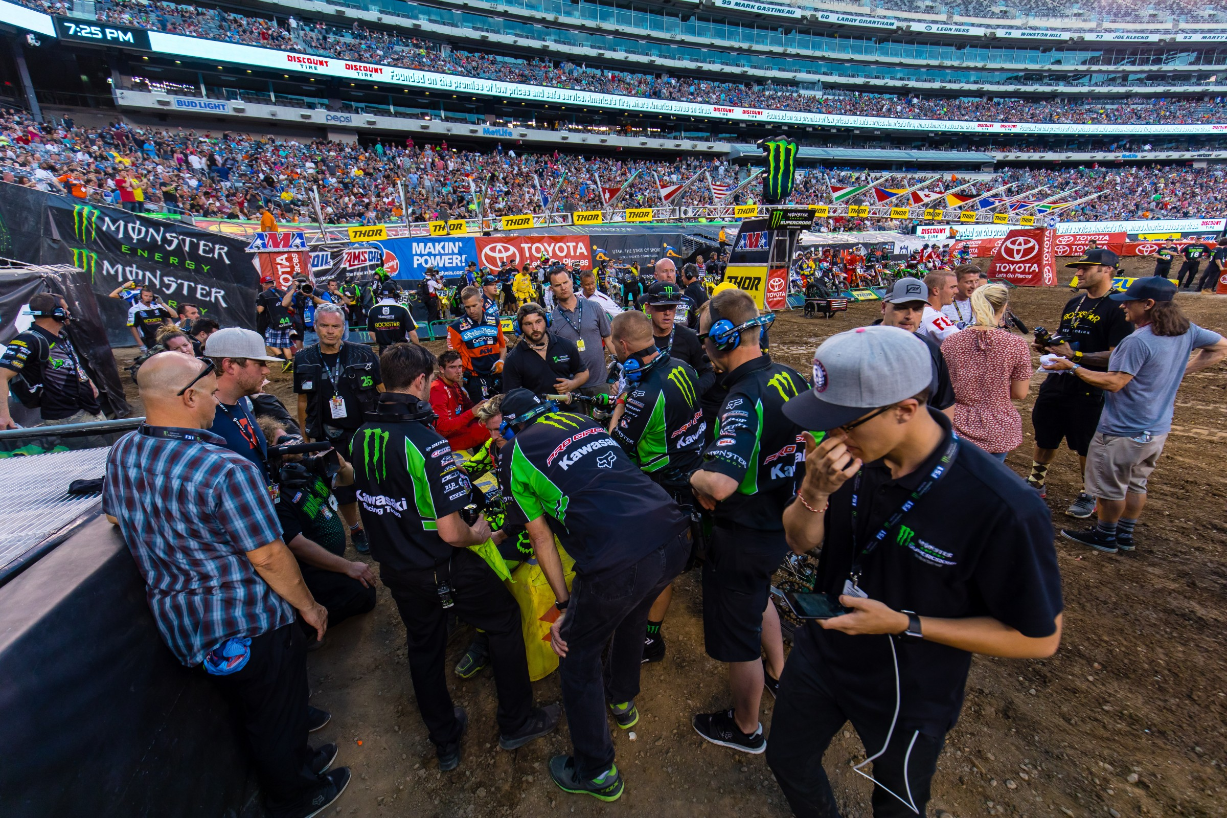 The Pro Circuit Kawasaki team huddles around Savatgy after a tough main event in East Rutherford.