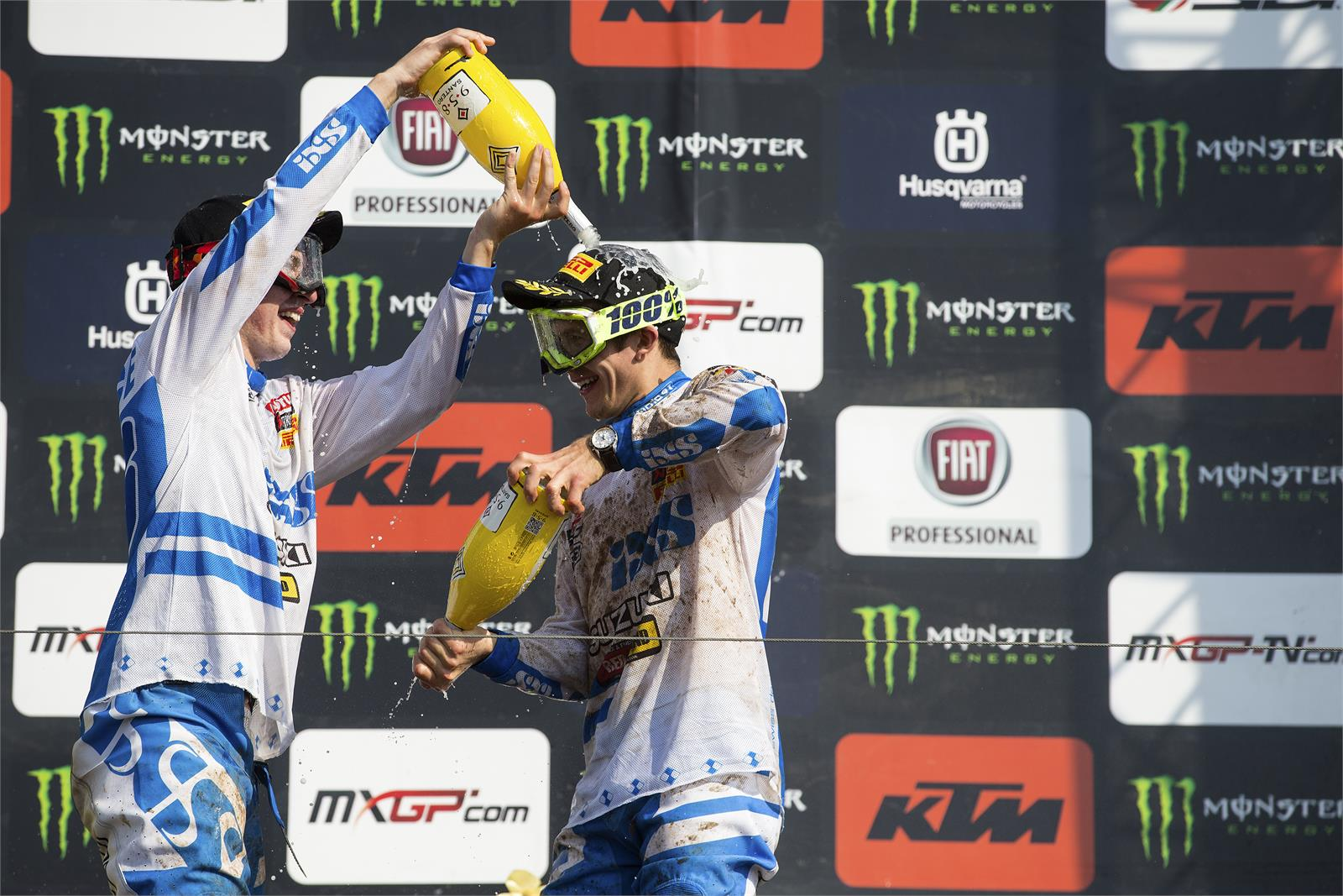 Seewer and Lawrence celebrate on the podium.