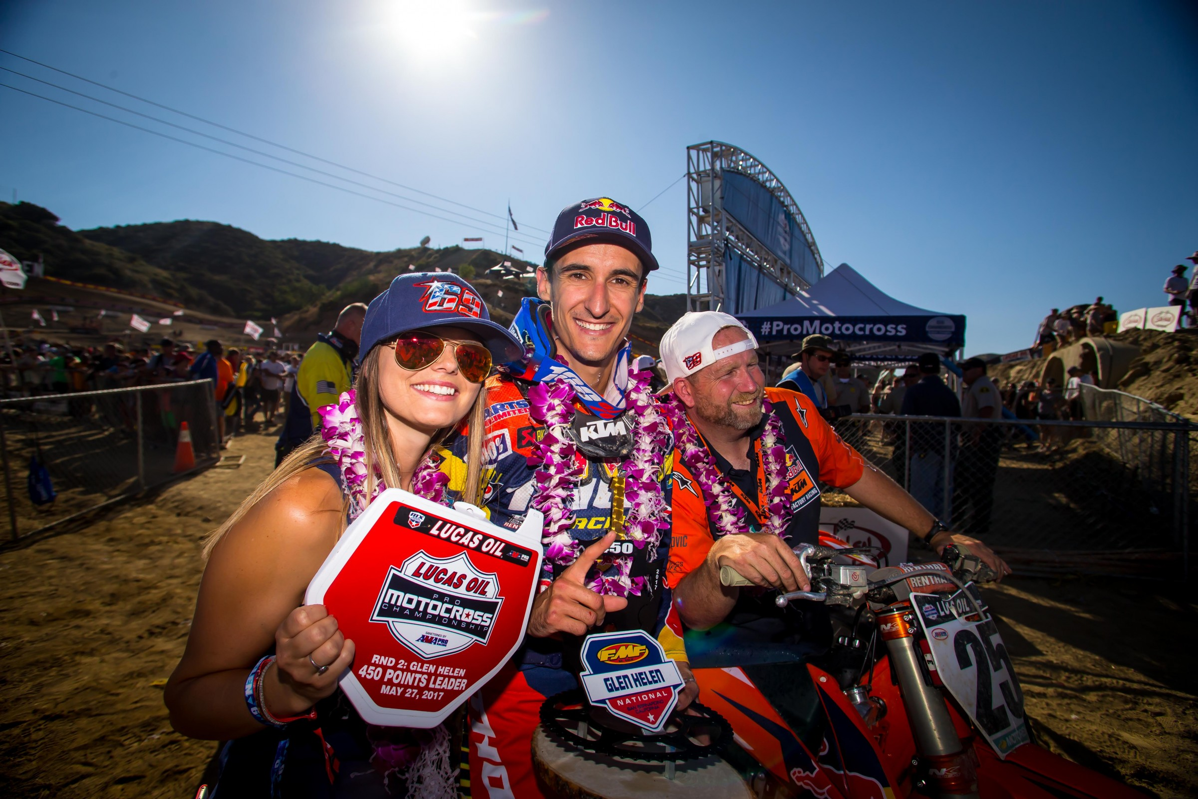 Musquin is surrounded by his wife, Mathilde, and his mechanic, Frankie Latham, after winning his first 450MX National.