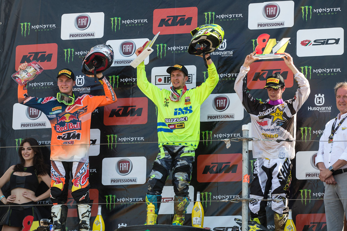 Jeremy Seewer (center) claimed the MX2 overall over Pauls Jonass (left) and Thomas Covington.