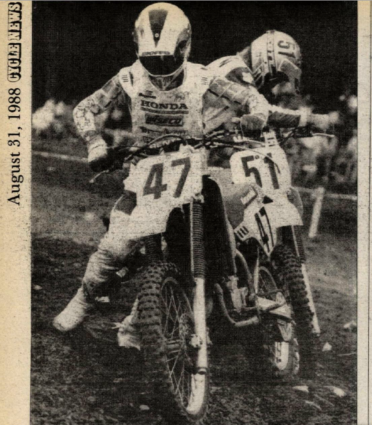 Emig (#47) and Bradshaw (#51) pick themselves up off the dirt at the back of the pack.