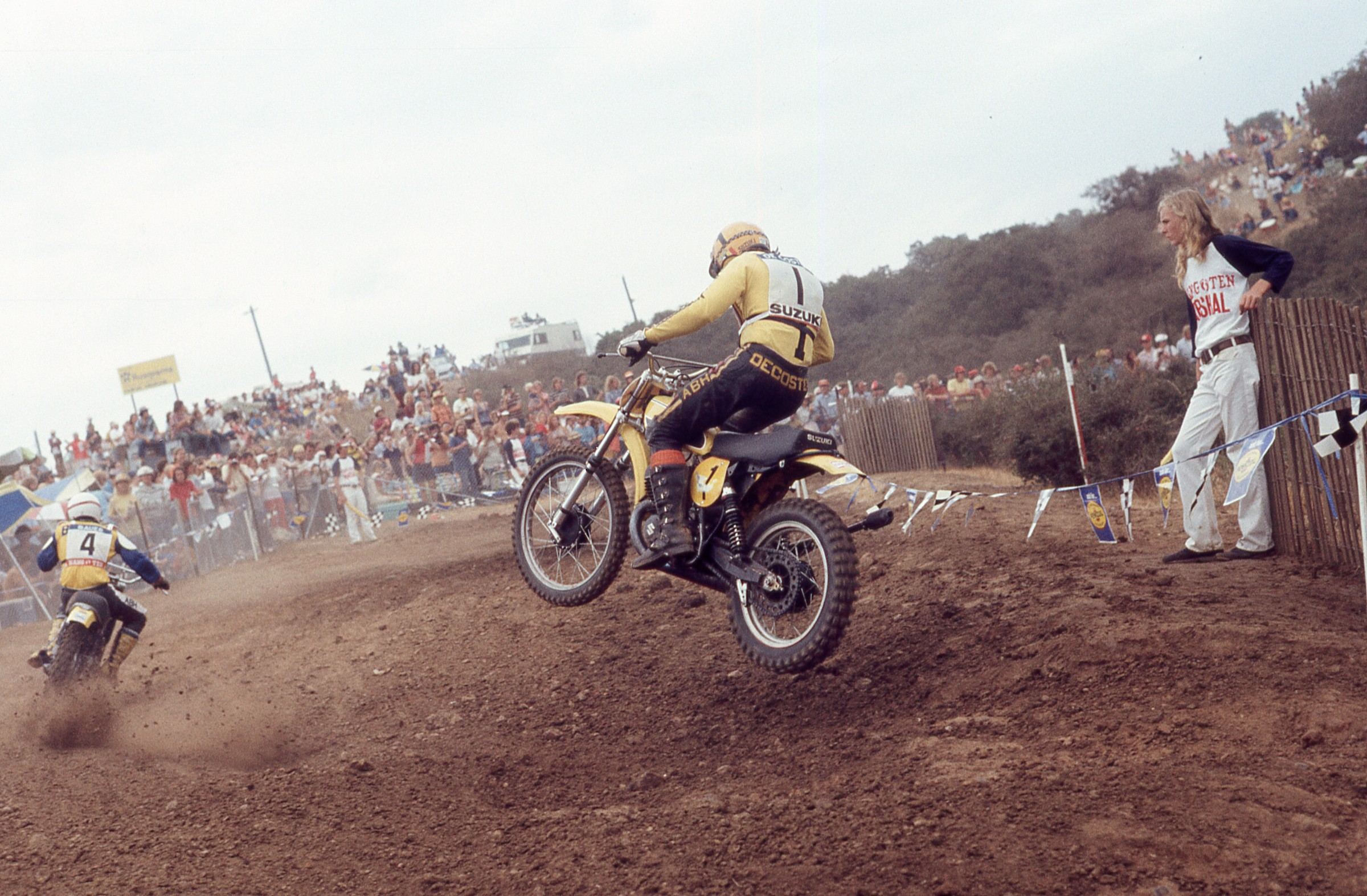 Roger DeCoster chases after Maico rider Willi Bauer.