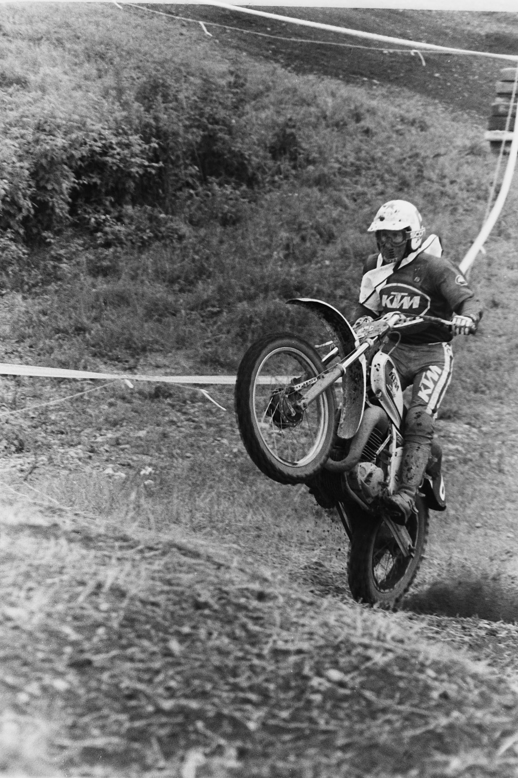 Soviet rider Vladimir Kavinov (6) wheelies his white KTM over some Unadilla bumps.